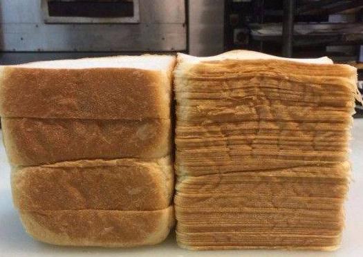 神级面包师1块吐司能切88片,薄得像纸、片片透光